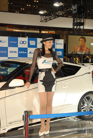 """Race queen"" is a Japanese term for a type of promotional model found as part of a pit crew in certain kinds of motor racing, such as F1 races. They generally wear some sort of revealing costume (mini-dress, swimsuit, hot pants, or the like), as well as pantyhose and high heels or knee-high boots. Race queens who operate in prestigious events and with a large fanbase can also be found at automobile shows purely to draw crowds where they are nearly as important an attraction as the cars or products that they are promoting."