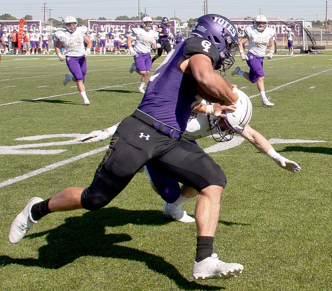 College of Idaho's 42 gets tackled by Carroll's Dawson Zebarth  during game against Carroll on October 2.<br /> by Jim Max