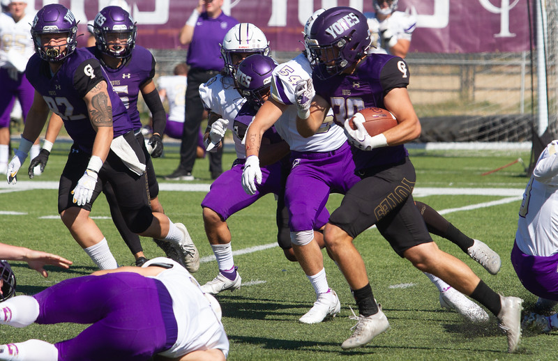 College of Idaho's Jared Lyon breaks for open ground during game against Carroll on October 2.<br /> by Jim Max