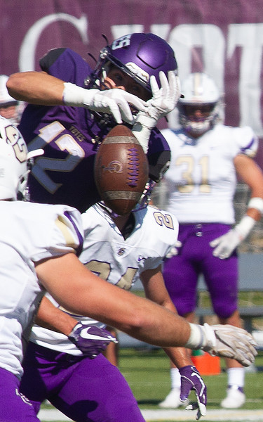 College of Idaho's 12 is not quite able to hang on to a pass during game against Carroll on October 2.<br /> by Jim Max