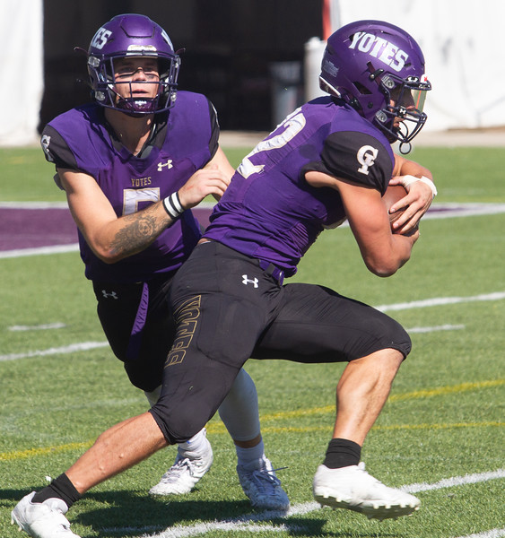 College of Idaho's Jack Rice hands ball off to 42 during game against Carroll on October 2.<br /> by Jim Max