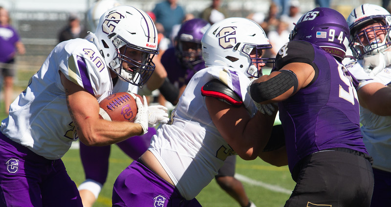 Carroll's Baxter Tuggle follows his blockers during game against College of Idaho on October 2.<br /> by Jim Max