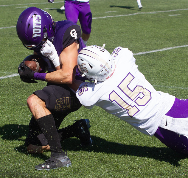 College of Idaho's 3 gets tackled by Carroll's Zach Spiroff during game on October 2.<br /> by Jim Max