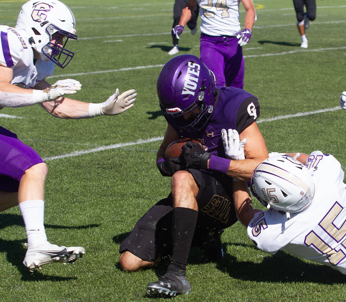 College of Idaho's 3 gets tackled by Carroll defense during game on October 2.<br /> by Jim Max