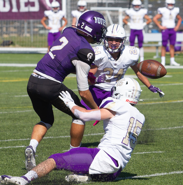 College of Idaho's 2 is not able to catch pass during game against Carroll on October 2.<br /> by Jim Max