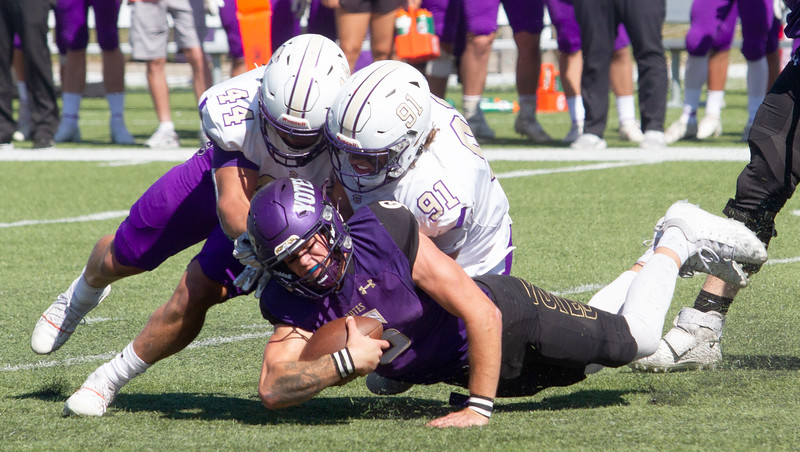 College of Idaho's Jack Rice is tackled on a keeper during game against Carroll on October 2.<br /> by Jim Max