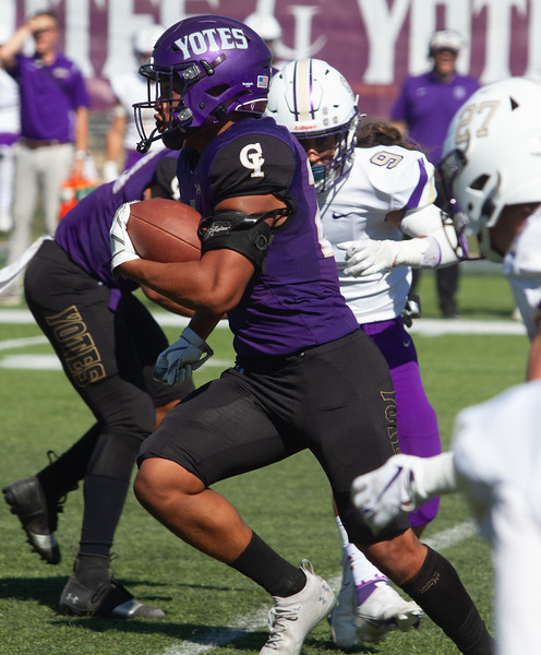 College of Idaho's 20 breaks for open ground during game against Carroll on October 2.<br /> by Jim Max