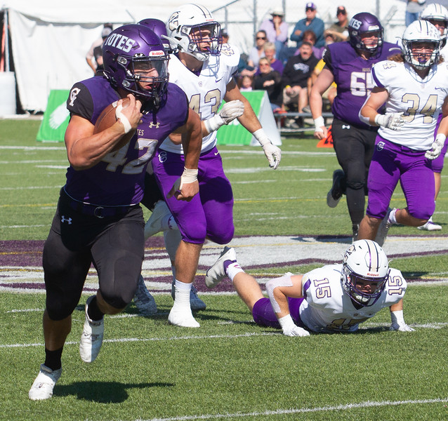 College of Idaho's 42 breaking for open ground during game against Carroll on October 2.<br /> by Jim Max