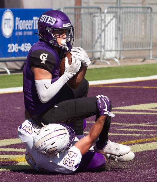 College of Idaho's 1 reels in a pass for a touchdown during game against Carroll on October 2.<br /> by Jim Max