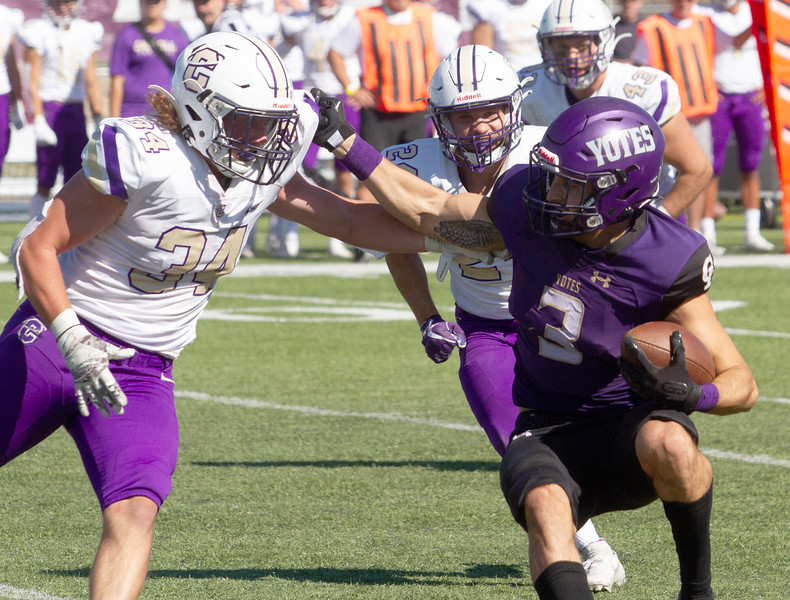 College of Idaho's 3 tries to avoid a Carroll defender during game on October 2.<br /> by Jim Max