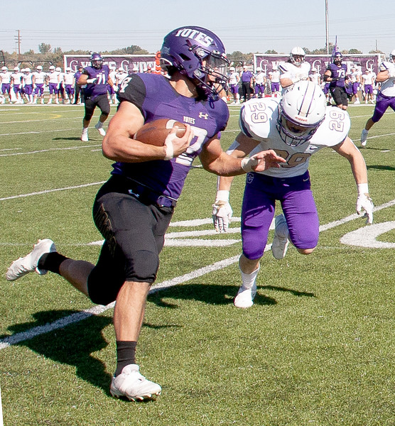 College of Idaho's 42 takes advantage of some open ground during game against Carroll on October 2.<br /> by Jim Max