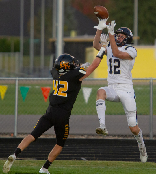 Middleton's Tyler Medaris goes up for a pass as Bishop Kelly's Angelo Quilici attempts to block.