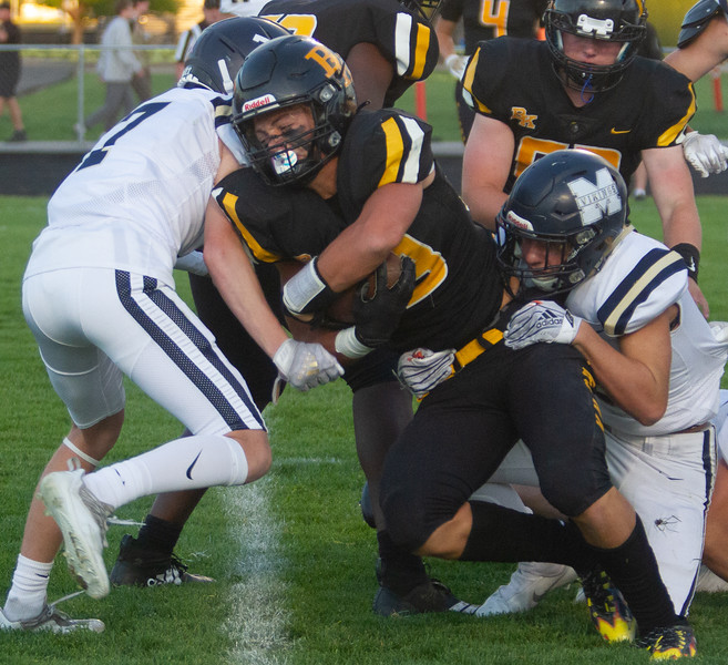 Bishop Kelly's Seth Knothe pushes forward for extra ground during match up with Middleton High School on October 1
