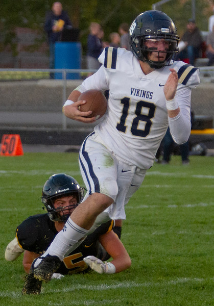 Middleton's Ky McClure evades a tackle during match up with Bishop Kelly on October 1.
