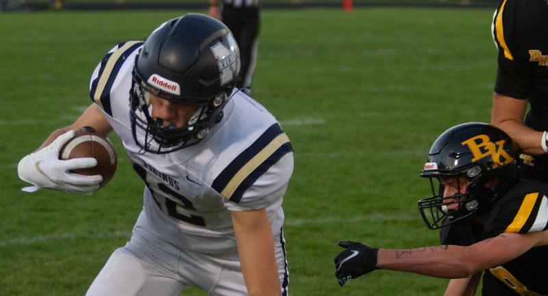 Middleton's Tyler Madaris runs after catching pass during match up with Bishop Kelly on October 1.