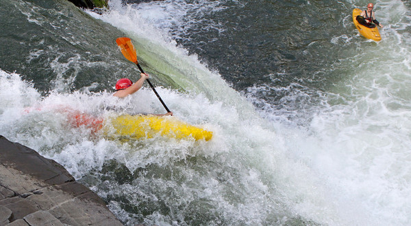 Kayaker runs the Spout on VA lines of Great Falls. July, 09.<br /> <br /> © Martin Radigan. All images copyright protected.