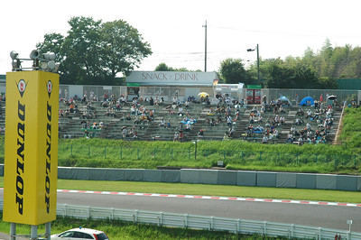 "The stands at the ""hairpin corve"" just before the start of the main event."