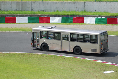 "The media bus thought it would take a spin around the track through the hairpin *CORVE, as it was dropping of the press photographers. CORVE = curve, this is ""bad English"" in Japan."
