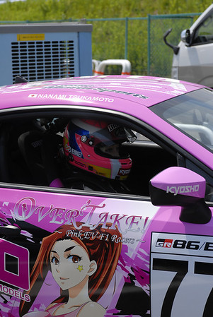 Who would ever want to drive in a pink car... who else -> a WOMAN, check her out behind the wheel!