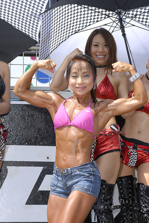 Flex for me... as always, female bodybuilder, Junko graces the pit walk with her amazing body!