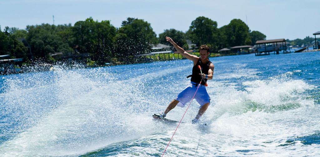 Photo of Paul hitting the wake on his wake skate on the bayous of Fort Walton Beach, Florida
