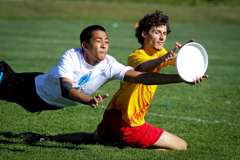 Blaine, MN: A Seattle player makes a defensive layout at Youth Club Championships 2013.