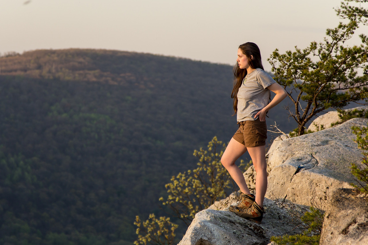 Jecca standing on the top of a cliff looking over the Susquhanna river.