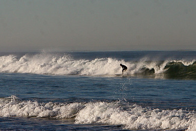 Smaller waves down the beach but solitude.