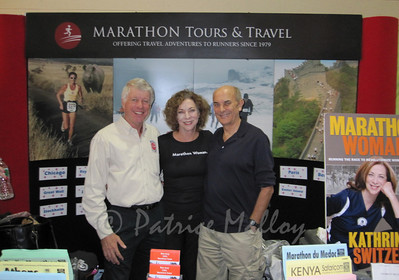 Thom Gilligan, founder and president of Marathon Tours and Travel, with Kathrine Switzer and Roger Robinson.