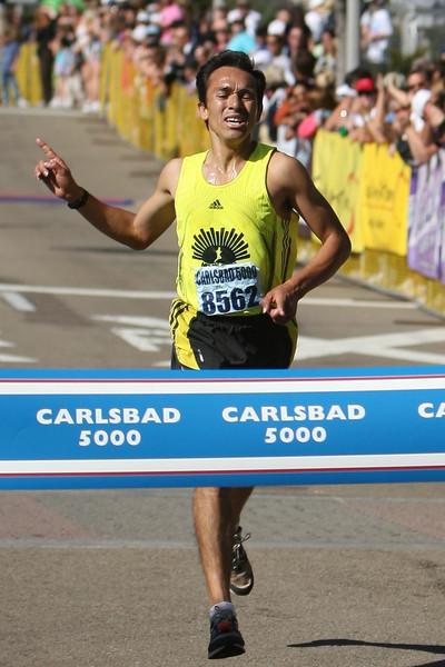 Romero wins in 14:51, 7 seconds ahead of Lander.