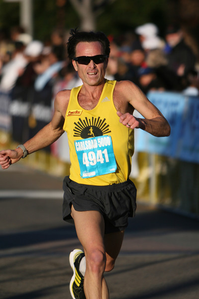 James Sheremeta, local master icon, finishes in 16:15, third in his 45-49 age group.