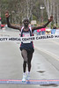 Stephen Sambu, 24, of Kenya winning the men's half-marathon division in 1:03:02 in his debut at the distance.