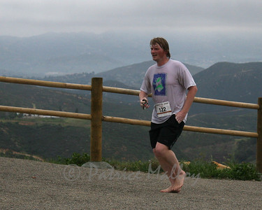 Chris Burrell, 34, of Escondido, ran the whole enchilada without shoes, finishing in 1:43:27.