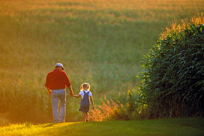 Farmer and daughter, Iowa.