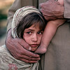 """<font size=""""3""""><font face=""""arial"""">A young refugee girl and her father near Freyzabad, Afghanistan, 1990"""