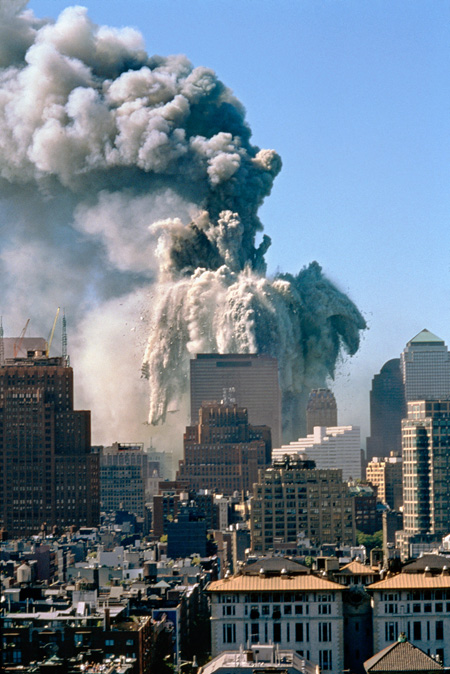 """<font size=""""3""""><font face=""""arial"""">The destruction of World Trade Center, Tower 1. Photographed from a roof at Washington Square Park and Fifth Avenue, NYC September 11, 2001. Building 7 can be seen in the foreground"""