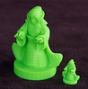 3d printed Elf Mage model from internet and 3x sized mage made with green fluorescent ABS plastic.