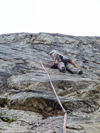 Pitch 9 (VI+), a slab without much of anything to hold on to reliably, proved to be too hard for us, so we started our descent just 40 meters from the end. At Abenteuer und Vergnügen.