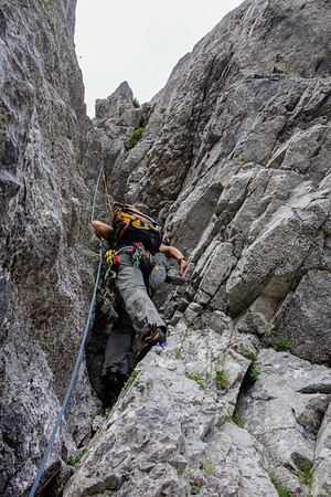 "Last proper climbing pitch on ""Salzburger Weg"": ""rauher Kamin"" (sharp chimney, IV+, nice climbing)."
