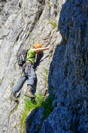 """We have ended up on the """"Graskopf"""" tower. An old rusty piton indicates that we are not first to take this way although the proper route is some 100 m to our right. Jesko pushes on over steepening rock."""