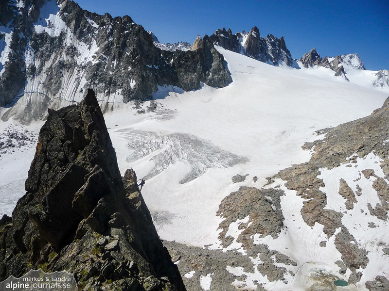 Sandra belaying on Aiguille d'Orny. Behind is Glacier d' Orny.