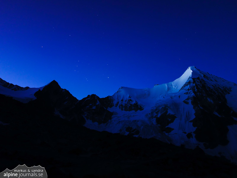 Dawn at Cabane du Grand Mountet. Orion is visible over Wellenkuppe next to Obergabelhorn (right).