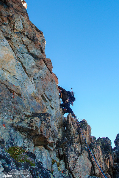 The actual climbing starts from a band up a high tower. One bolt some way further up.