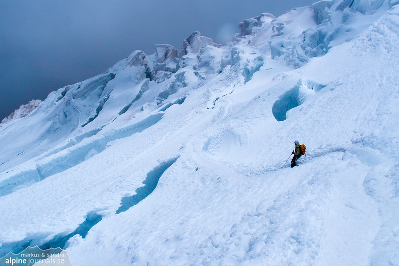 Approaching a crevasse and serac dense region of the glacier.