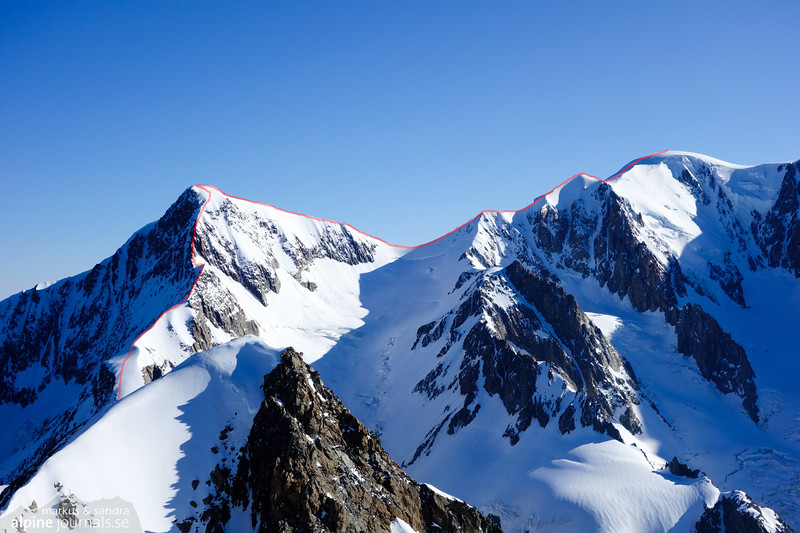 The Bionassay traverse as seen from Tête Blanche Point 3750. The ridge in the front hides the the Durier hut from view; situated further down to the left on a saddle. After Bionassay (4052 m) the traverse continues eastward via Col de Bionassay and Piton des Italiens to Dôme du Gôuter. Further right, outside the picture, is Mt Blanc.