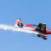 Extra 300 in flight, smoke on.