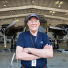 "This is ""Caribou"" Bob Schrader. He was the crew chief on the very airplane parked behind him, when it flew in Vietnam. He's now a volunteer at the Cavanaugh Flight Museum and helps keep it in working order."