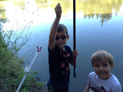 His first fish with the long pole (bluegill)
