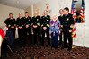 Firemen Jim Jacoby, Andrew Disque, Jack Ballard, Nick Barber, and Jim Smart receive awards for rescuing Anna Kozak from her burning house in March of 2008. Fire Chief Jim DeHart lll is shown on the left. Anna Kozak is next to James Smart. Photo by Ed MacDonald