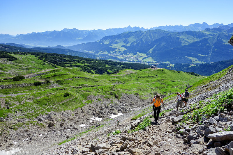 Ascending on scree from Ifenhütte to Hohe Ifen summit plateau, with a view of Kleinwalsertal behind.